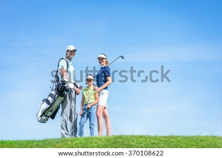 Happy family on the golf course - stock photo