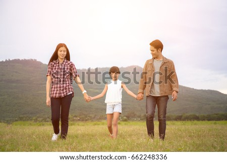 Happy family on the meadow on holiday