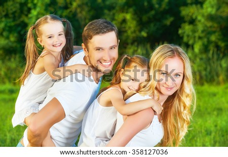 happy family on the nature of the summer, mother, father and children twin sisters