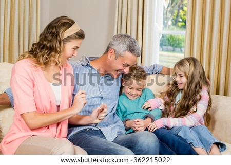 Happy family on the sofa in living room - stock photo