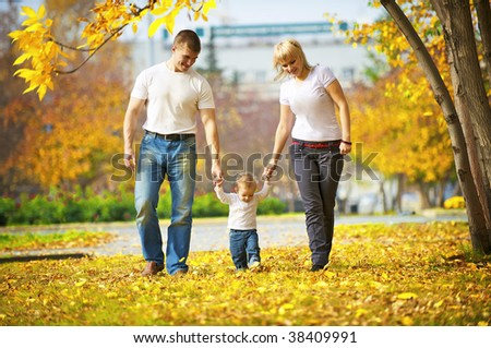 Happy family on the walk with young son - stock photo
