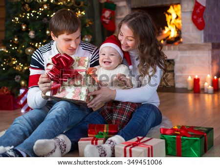 Happy family opening gifts on Christmas and New Year
