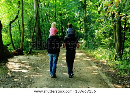 happy family outdoors - stock photo