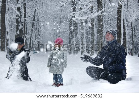 happy family outdoors in the park in winter