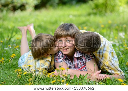 Happy family outdoors on the grass in a park
