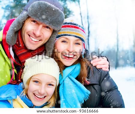 Happy Family Outdoors. Snow.Winter Vacation - stock photo