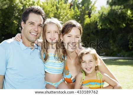 Happy family outside in a hot summer day - stock photo