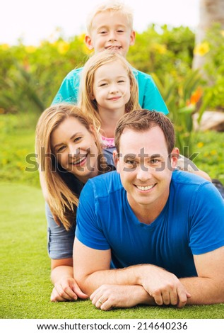 Happy Family Outside on Grass - stock photo