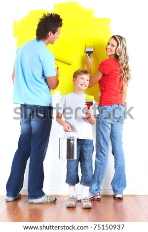Happy family painting interior wall of home. - stock photo