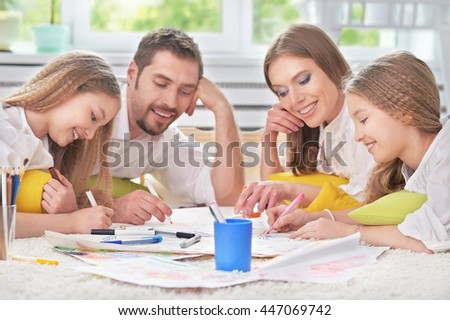 happy family painting together - stock photo