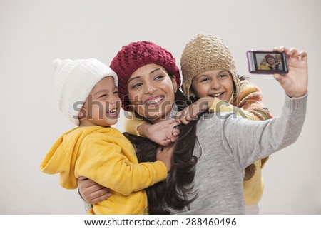Happy family photographing themselves - stock photo