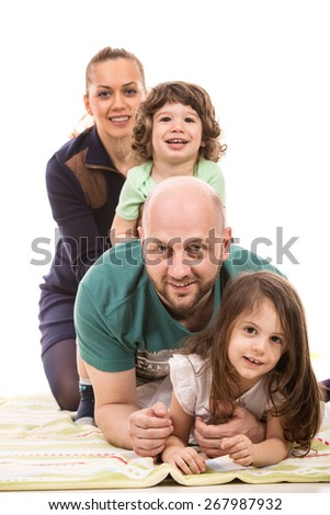 Happy family piled on top of little girl home having fun isolated on white background - stock photo