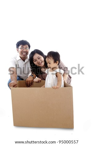 Happy family play with a box isolated on white background - stock photo