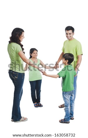 Happy family playing - stock photo