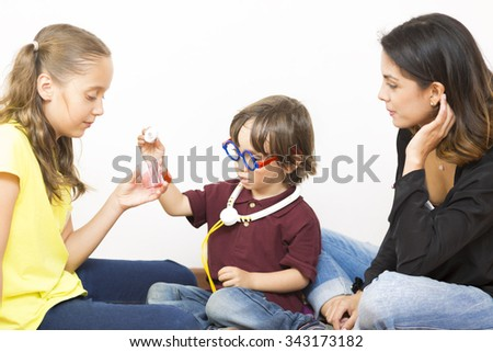 Happy Family Playing, Mother and her Girl and Boy Enjoying at Home - stock photo