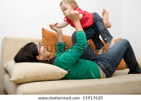 happy family playing on sofa - stock photo
