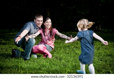Happy Family Playing On The Grass - stock photo