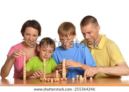Happy Family playing on white background - stock photo