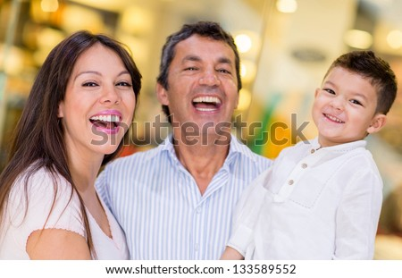 Happy family portrait at a shopping center - stock photo