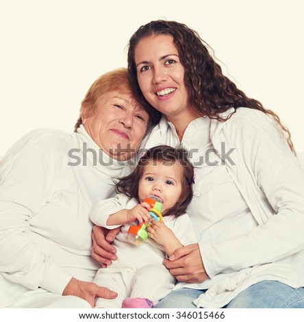 happy family portrait - grandmother, daughter and granddaughter