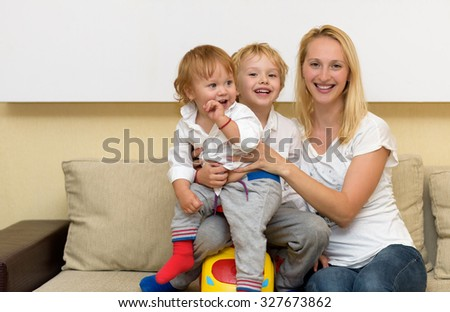 Happy Family portrait. Mom and her sons - stock photo