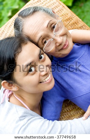 Happy Family Portrait of Asian Daughter Embrace her Old Mother Lovingly - stock photo