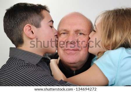 happy family portrait of elderly father with his daughter and son - stock photo