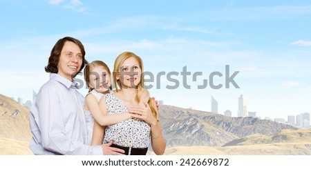 Happy family portrait of mother father and daughter - stock photo