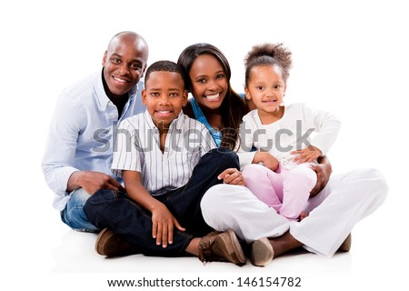 Happy family portrait sitting on the floor - isolated over white