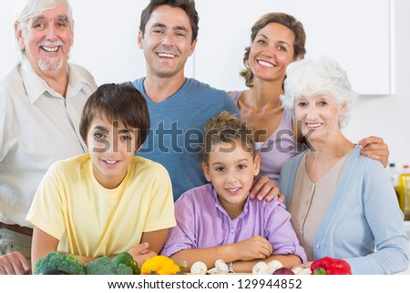 Happy family posing in kitchen