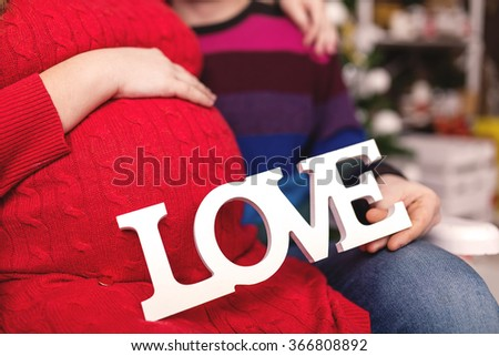 Happy family. Pregnant young mother with her husband. Love Concept. - stock photo