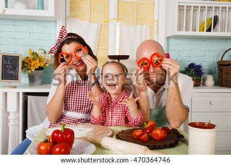 Happy family prepares in the kitchen