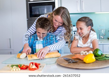 Happy family preparing lunch together at home in the kitchen