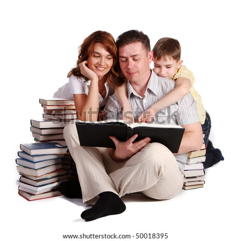 Happy Family reading a book - stock photo