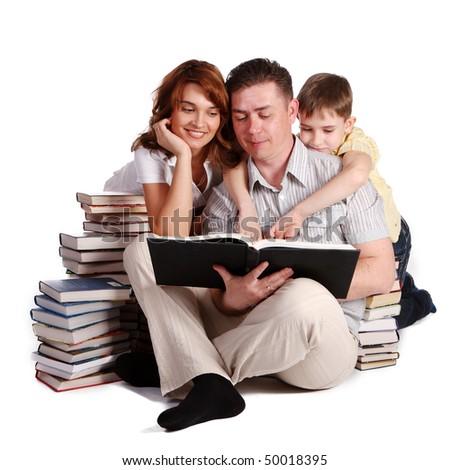 Happy Family reading a book - stock photo