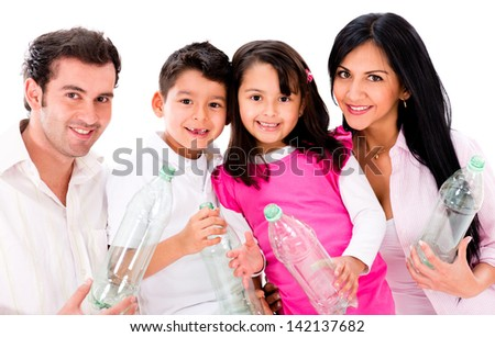 Happy family recycling plastic bottles - isolated over white - stock photo