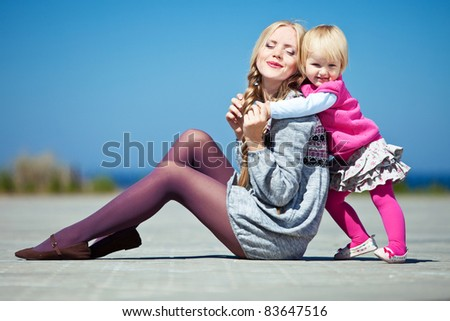 Happy family relaxing by the sea - stock photo
