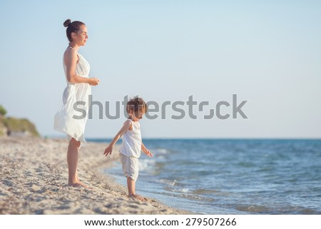 Happy family relaxing on the beach