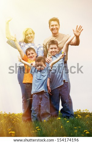 Happy family relaxing outdoors. summer vacation background.