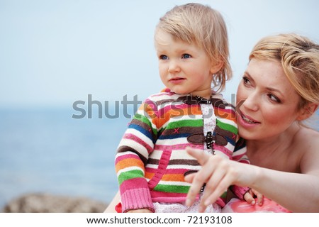 Happy family resting at beach - stock photo