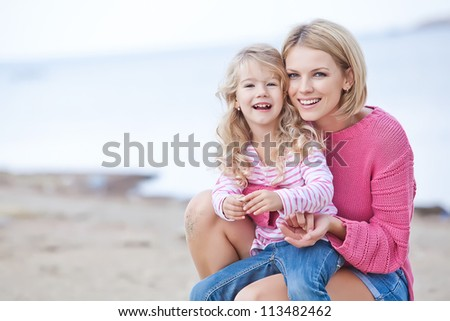 Happy family resting at beach in summer - stock photo