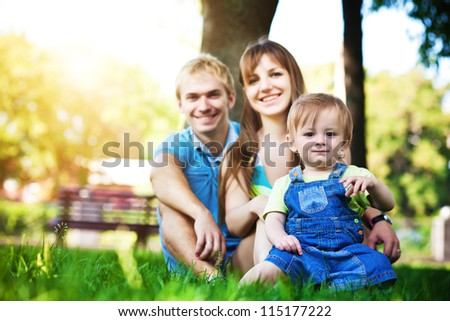 happy family resting in the summer park. picnic