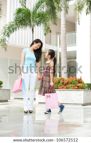 Happy family shopping in the mall - stock photo