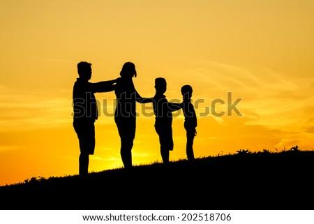 Happy family silhouette - stock photo