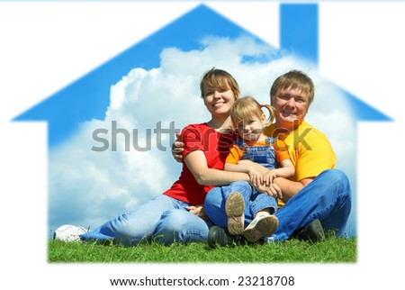 happy family sit in house on green grass under sky with clouds - stock photo