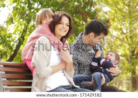 Happy family sitting in the park