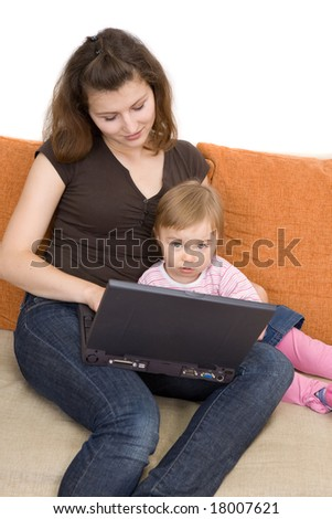 happy family sitting on sofa with laptop - stock photo