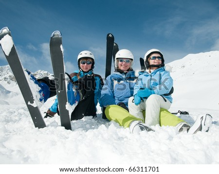 Happy family ski team - stock photo