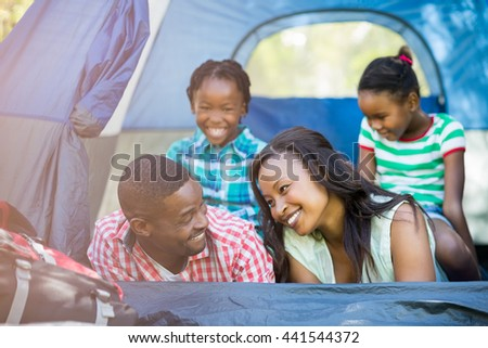 Happy family smiling at park