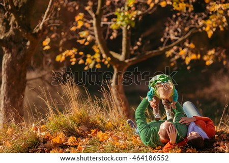 happy family spend time in autumn forest